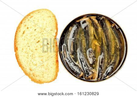 The open metal can of sprats and cut off a piece of loaf.
