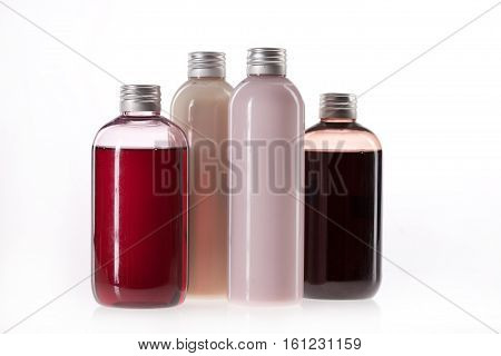 Bottles with multicolored on an isolated background