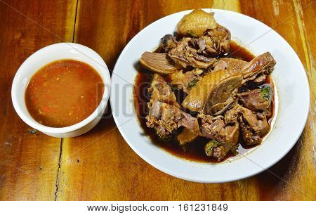 steamed duck meat in Chinese brown soup with spicy and sour sauce