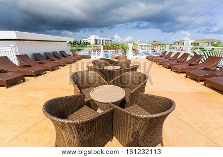 Cayo Guillermo island, Iberostar Playa Pilar hotel, Cuba, June 28, 2016, amazing gorgeous view of various modern stylish outdoor patio furniture near the swimming pool