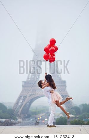 Romantic Couple With Red Balloons Together In Paris