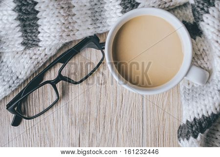 coffee cup with glasses on the scarf and Wooden in vintage tone