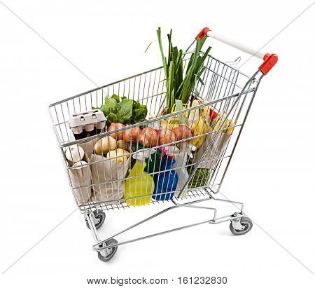 Shopping cart full of grocery isolated on white background.