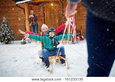 Family enjoying -winter, snow, family sledding at winter time