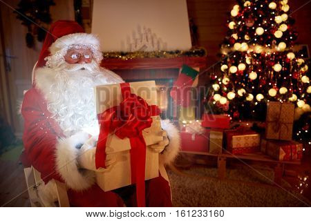 Magical present in Santa Claus hands, happy marry charismas