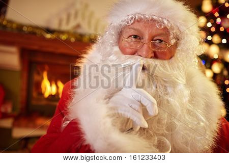 Santa holding a finger to his mouth, silence for Christmastime