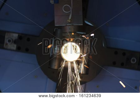 The tube or pipe laser cutting machine while cutting the tube or pipe with the sparking light