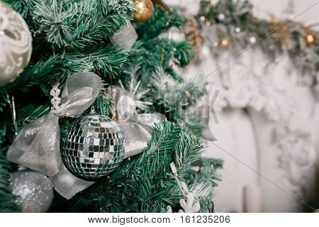 decorative cinnamon and dried fruit close-up. Decorated Christmas tree on blurred, sparkling and fairy background.