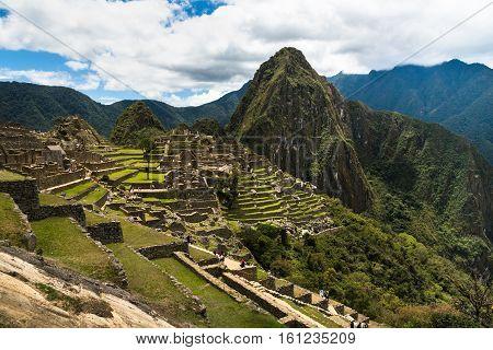 View of the Lost Incan City of Machu Picchu near Cusco, Peru. Machu Picchu is a Peruvian Historical Sanctuary. Terraces can be seen on foreground.