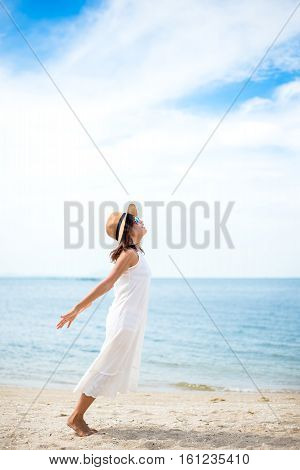 Young women jumping and happy on the beach. Travel and Vacation. Freedom Concept