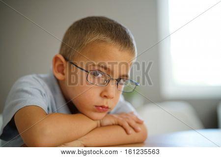 Portrait of 4-year-old boy wearing eyeglasses