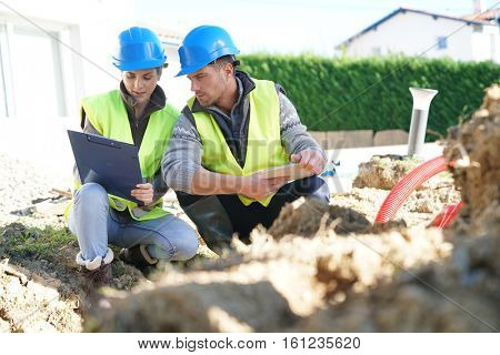 Construction site professional looking at digging in work
