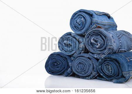 rolls of jeans, denim texture, composition, stack of denim pants