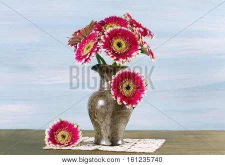 Still-life with a bouquet of gerberas in a vase