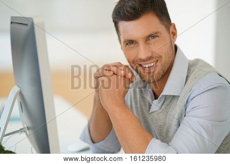 Handsome businessman working for startup company