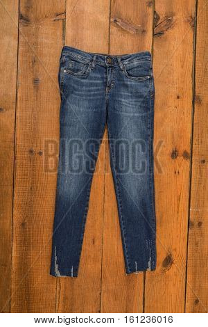 jeans trouser on wood background
