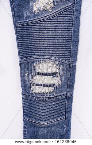 Leg Jeans torn denim texture.