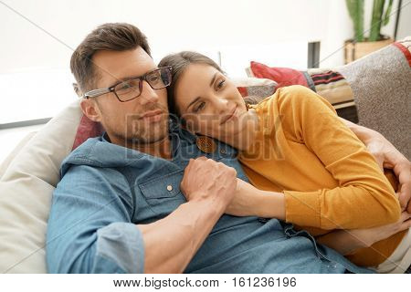 Couple home relaxing in sofa and watching tv