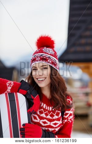 sexy woman with snowboard outdoors