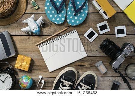 travel planning on wooden background, top view