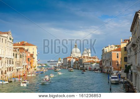 VENICE, ITALY - September 20, 2016. Beautiful view of water street and old buildings in Venice on May 26, 2015. its entirety is listed as a World Heritage Site, along with its lagoon. VENICE, ITALY
