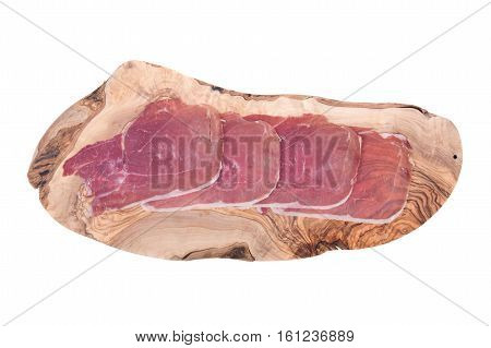 Boneless sliced italian dry-cured ham prosciutto on olive wood cutting board isolated on white background