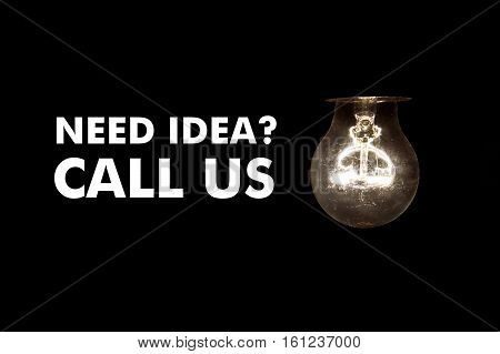 Bulb with message NEED IDEA CALL US