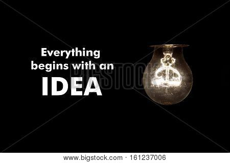 Bulb with message EVERYTHING BEGINS WITH AN IDEA