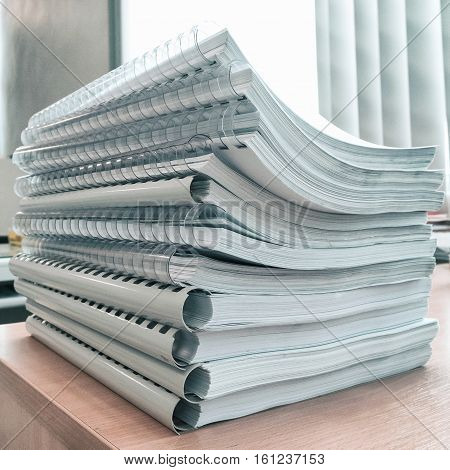 The Pile of papers on the desks