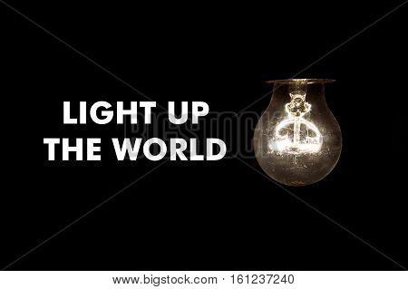Bulb with message LIGHT UP THE WORLD