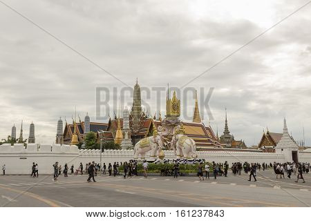BANGKOK THAILAND - NOV 13 : scene of mourners on Ratchadamnoen Nai road in sanam luang area while the funeral of king Bhumibol Adulyadej in Grand Palace on november 13 2016