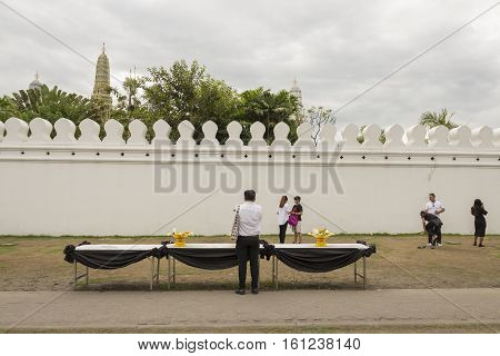 BANGKOK THAILAND - NOV 13 : people worship for king Rama 9 at wall of Wat Phra Kaew while the funeral of king Bhumibol Adulyadej in Grand Palace on november 13 2016