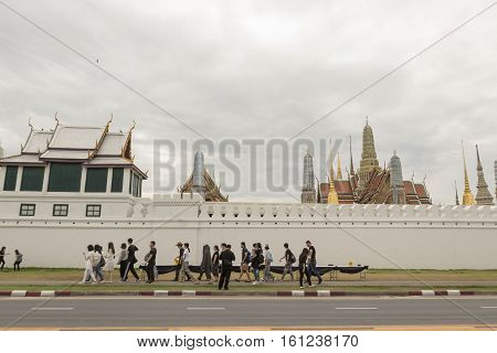 BANGKOK THAILAND - NOV 13 : tourist walk through outside Wat Phra Kaew while the funeral of king Bhumibol Adulyadej in Grand Palace on november 13 2016