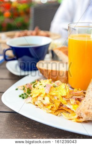 Breakfast with orange juice and fresh omelet on table