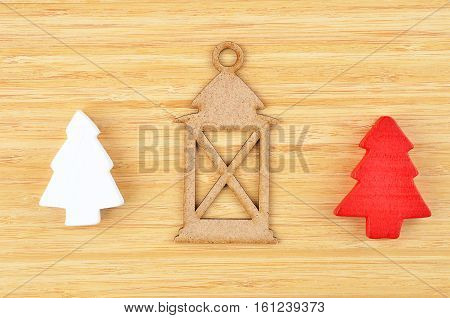Christmas tree and lantern on natural wooden background