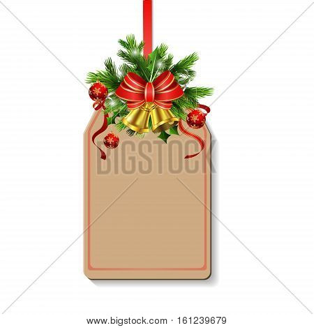 Christmas decoration with bow and balls and christmas tree brunches and two golden bells on tag with free space