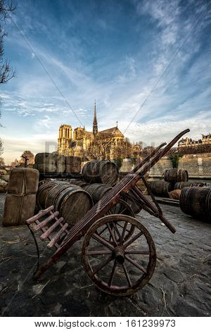 Docks of Notre Dame Cathedral in Paris in the 18th century  with old barrels, France