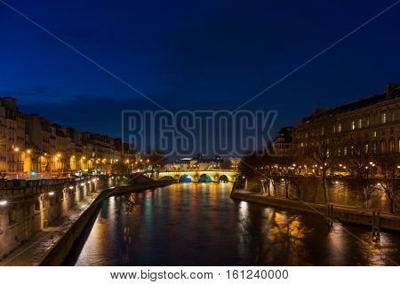 Bridge by the Seine river in Paris at night