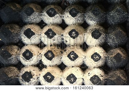 abstract egg paper tray with the ashes charcoal cover on it