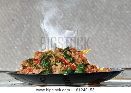 Aroma Smell Fried Spicy Basil With Minced Pork Topped Lettuce.
