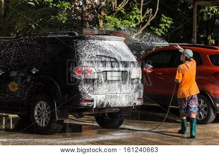 Phuket, Thailand - November 3 : An Unidentified People Spraying Water From High Pressure Washer To W