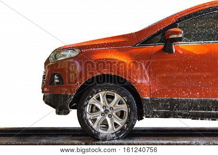 Orange Car With White Soap On The Body In Car Care Shop