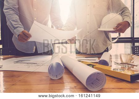 Architect Concept, Architects Working With Blueprints In The Office, Vintage Effect