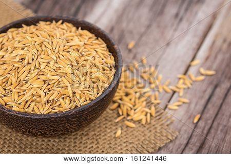 Yellow Thai Paddy Jasmine Rice On Wooden Plank