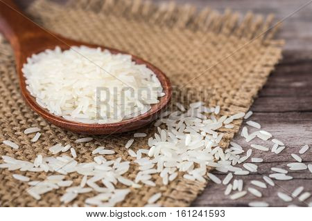 White Thai Jasmine Rice On Wooden Plank