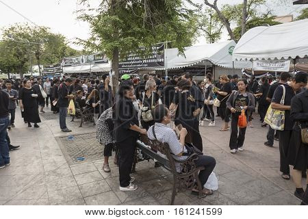 BANGKOK THAILAND - NOV 19 : crowd of mourners in Sanam Luang area while the funeral of king Bhumibol Adulyadej in Grand Palace on november 19 2016