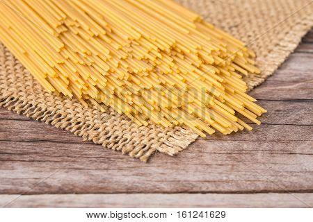Yellow Long Spaghetti,  Raw Spaghetti On Wooden
