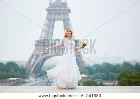 Beautiful Bride In White Dress Near The Eiffel Tower