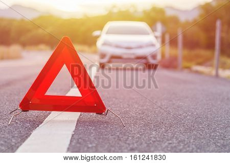 Emergency Stop Sign And Broken Silver Car On The Road