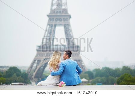 Just Married Couple Near The Eiffel Tower In Paris